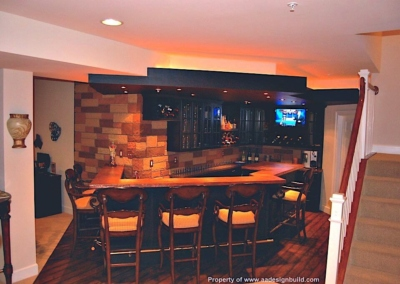 Remodeling basement Home Theater Bar English Pub Ponte Vedra Hammered Copper Counter