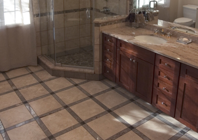 Design Ponte Vedra master bathroom corner shower enclosure floor tile long granite counter top